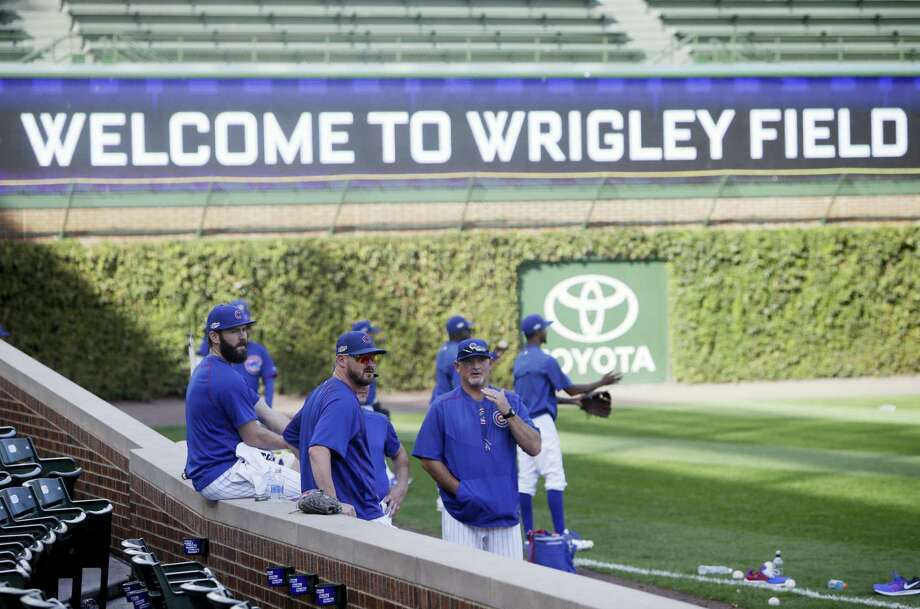 Chicago Cubs Chicago Cubs pitcher Jake Arrieta, left, relaxes as players warm up during baseball practice at Wrigley Field on Oct. 5, 2016 in Chicago. The Cubs host the winner of Wednesday's National League wild-card game between the New York Mets and San Francisco Giants on Friday, in Game 1 of the National League Division Series. Photo: AP Photo/Kiichiro Sato   / Copyright 2016 The Associated Press. All rights reserved.