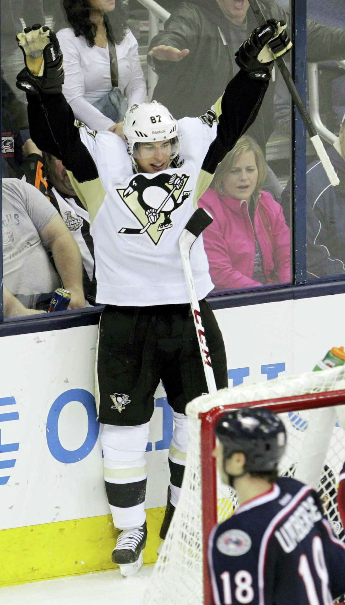 Pittsburgh Penguins' Sidney Crosby celebrates his goal against the Columbus Blue Jackets during the third period of an NHL hockey game on Dec. 29, 2013, in Columbus, Ohio. The Penguins won 5-3.