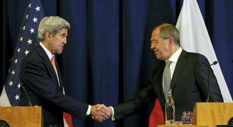 U.S. Secretary of State John Kerry, left, and Russian Foreign Minister Sergei Lavrov shake hands at the conclusion of a joint press conference following their meeting in Geneva, Switzerland Friday, Sept. 9, 2016. Photo: Kevin Lamarque — Pool Photo Via AP / POOL Reuters