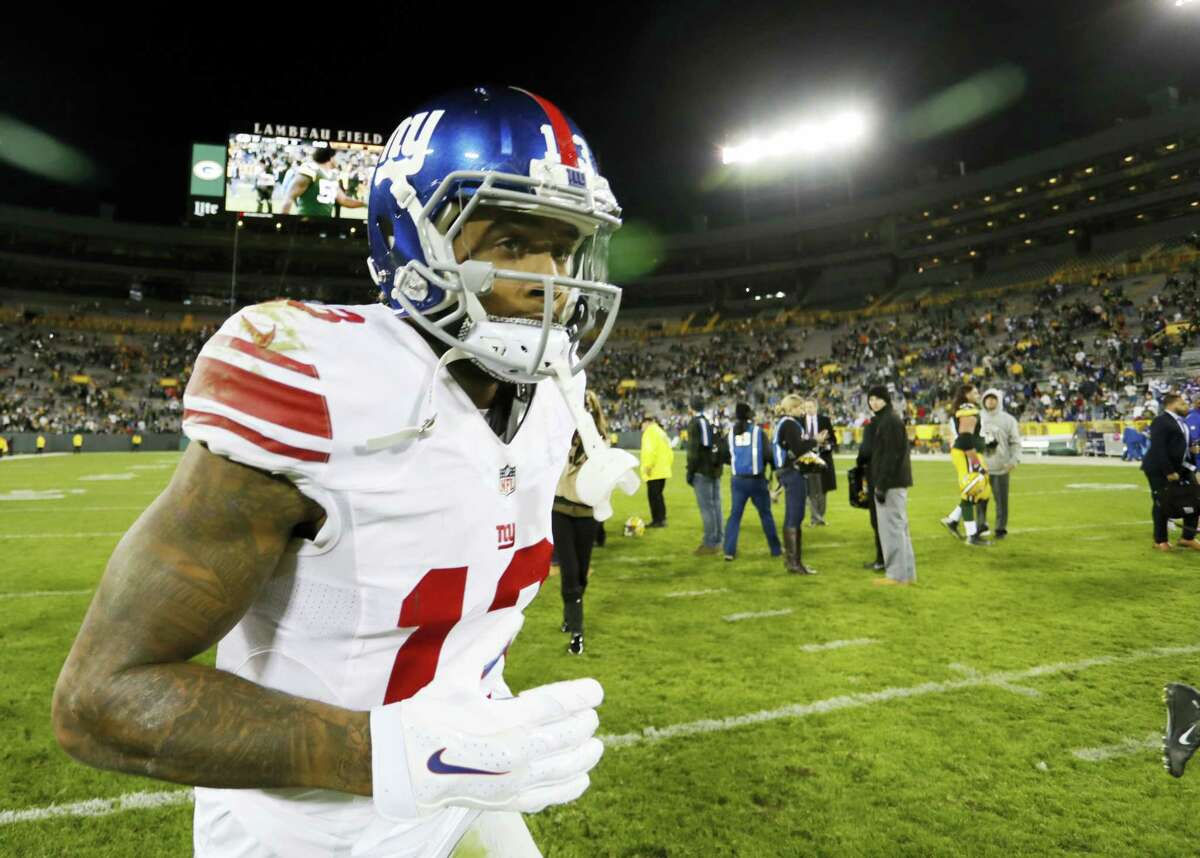 The Giants' Odell Beckham leaves the field after Sunday night's loss to the Packers.