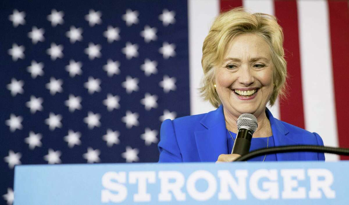 Democratic presidential candidate Hillary Clinton pauses while speaking at a rally at Johnson C. Smith University, in Charlotte, N.C., Thursday, Sept. 8, 2016.