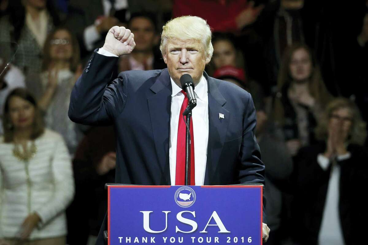 President-elect Donald Trump speaks during the first stop of his post-election tour Thursday in Cincinnati.