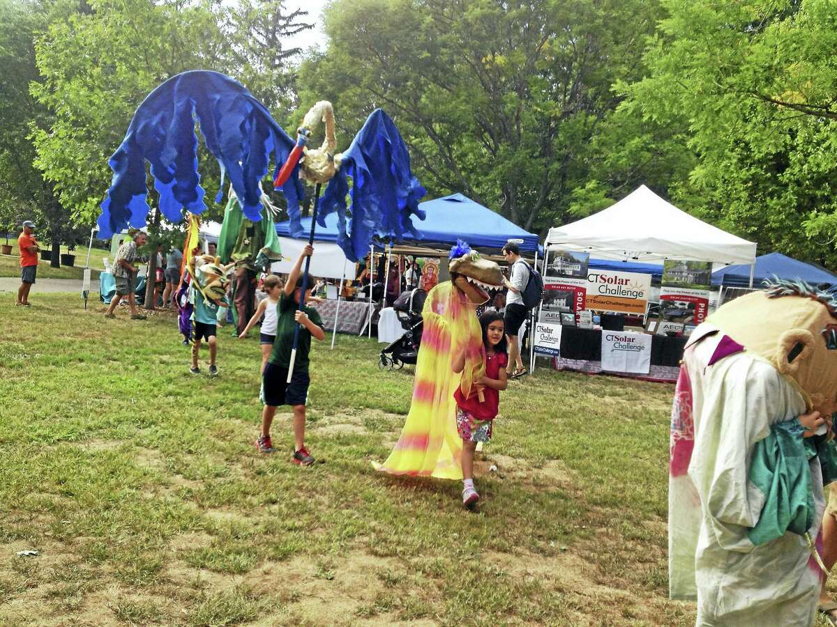 Kids enjoy the puppet parade that was part of the Green Expo at the CT Folk Festival and Green Expo Saturday at Edgerton Park in New Haven.
