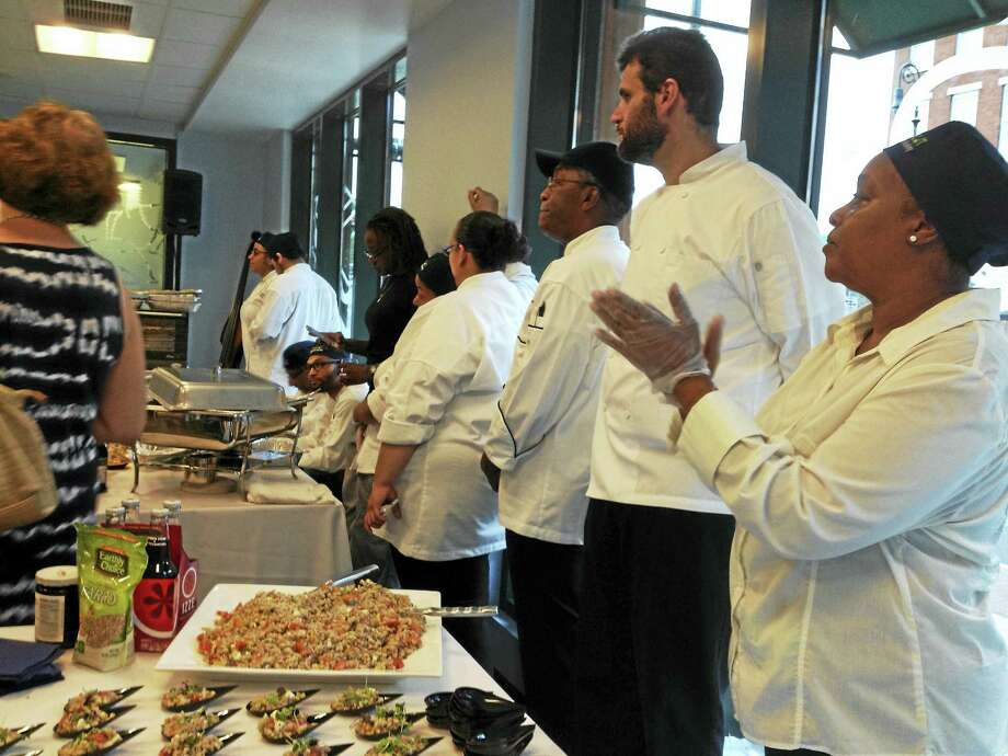 Students in the Connecticut Center for Arts and Technology culinary training program and their teachers listen to officials speak at ConnCAT's culinary showcase Saturday at Elm City Market in New Haven. Photo: Mark Zaretsky — New Haven Register