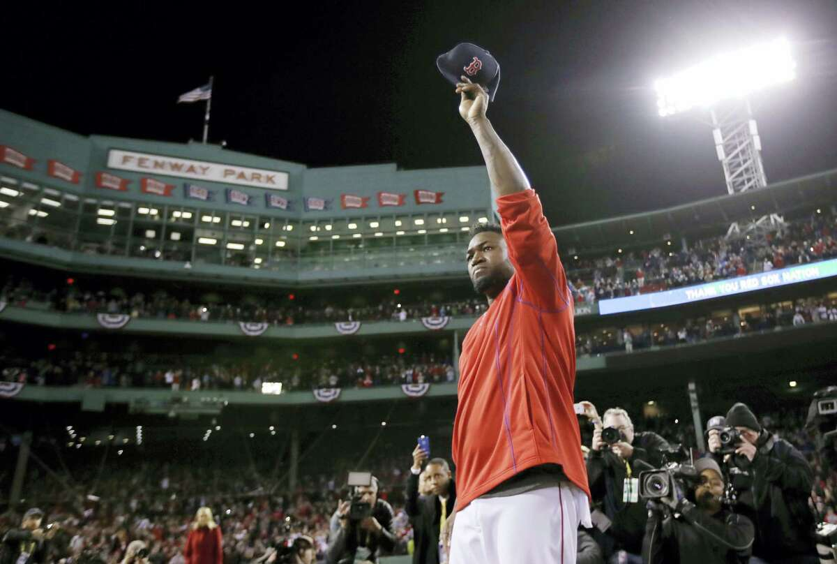 David Ortiz waves from the mound at Fenway Park after Monday's game. The Indians won 4-3 to sweep the Red Sox in the series. Ortiz said he will retire at the end of the season.