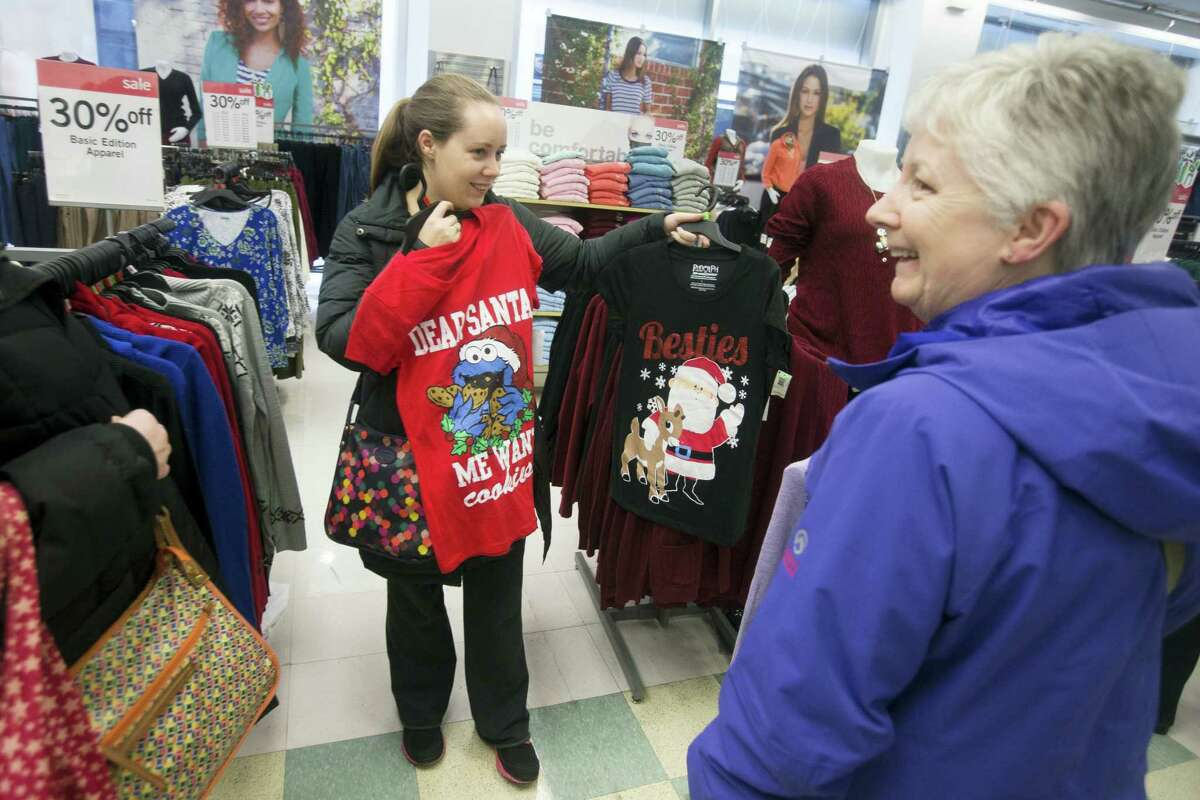 Joanne De Korte, of Ireland, shops with her relatives at Kmart, Thursday, Nov. 27, 2014, in New York. Millions of customers are expected to shop on Thanksgiving Day as many retailers remain open on a day traditionally reserved for spending time with family.