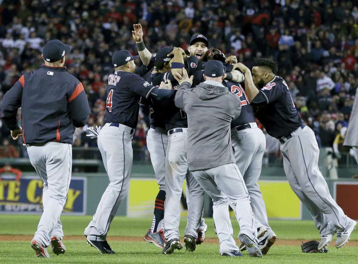 The Indians celebrate their win over the Red Sox on Monday.