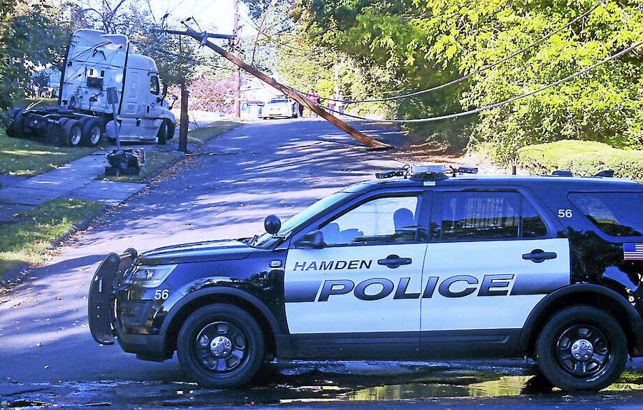 High Top Circle in Hamden was shut down at Pine Rock Avenue for hours Monday morning after a truck crashed into a utility pole, snapping it in half and taking down several hours. No one was hurt in the accident. Photo: Wes Duplantier — The New Haven Register