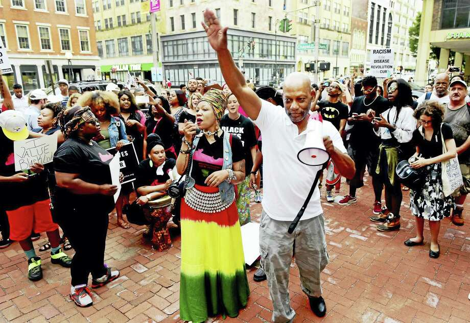 Lia Miller-Granger of Black Lives Matter New Haven, left, and Cornell Lewis of Moral Monday Connection of Hartford lead a Black Lives Matter rally Friday on the New Haven Green by the corner of Church and Chapel streets. Photo: Peter Hvizdak — New Haven Register   / ©2016 Peter Hvizdak