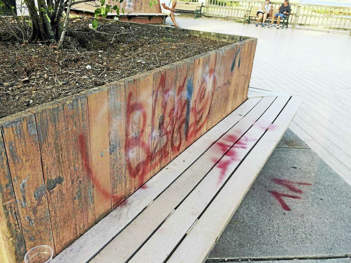 Vandals defaced the benches and planters along the boardwalk with graffiti.