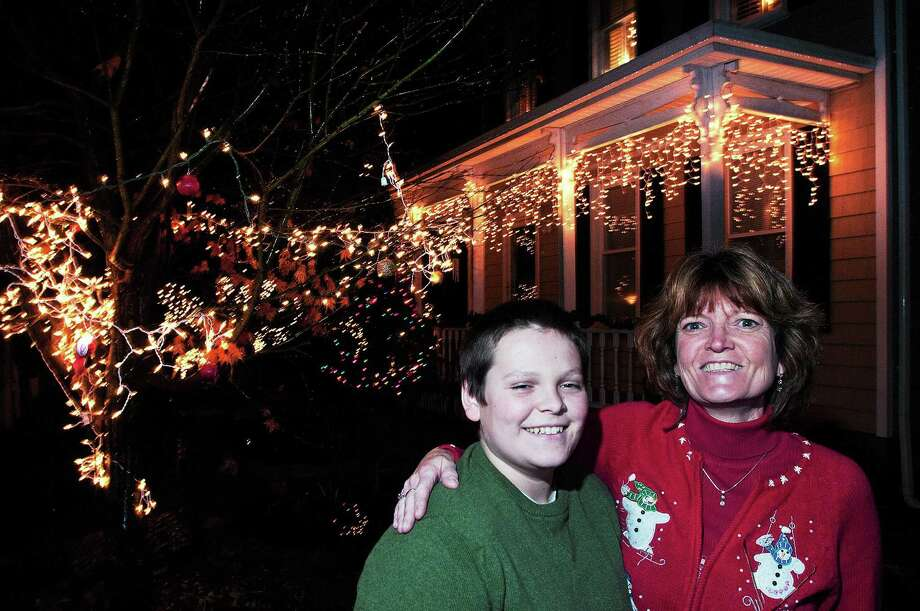 "Janet Viarius Waugh and her son, Christopher, at their home on Prospect Street that won the 3rd annual ""Holiday Home & Yard"" decorating contest. Photo: Peter Casolino — New Haven Register File Photo"
