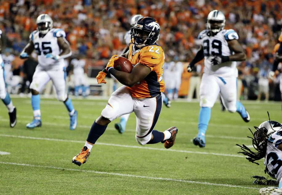 Broncos running back C.J. Anderson (22) runs in for a touchdown against the Panthers on Thursday. Photo: Jack Dempsey — The Associated Press   / FR42408 AP