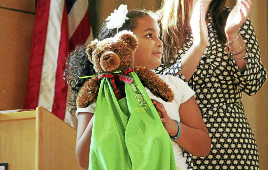 King-Robinson Interdistrict Magnet School third-grader Jayla Johnson holds up one of the care bags she and her classmates made for children at Yale New Haven Children's Hospital Child Life program, during a ceremony Friday at the school's auditorium. Photo: Esteban L. Hernandez — New Haven Register