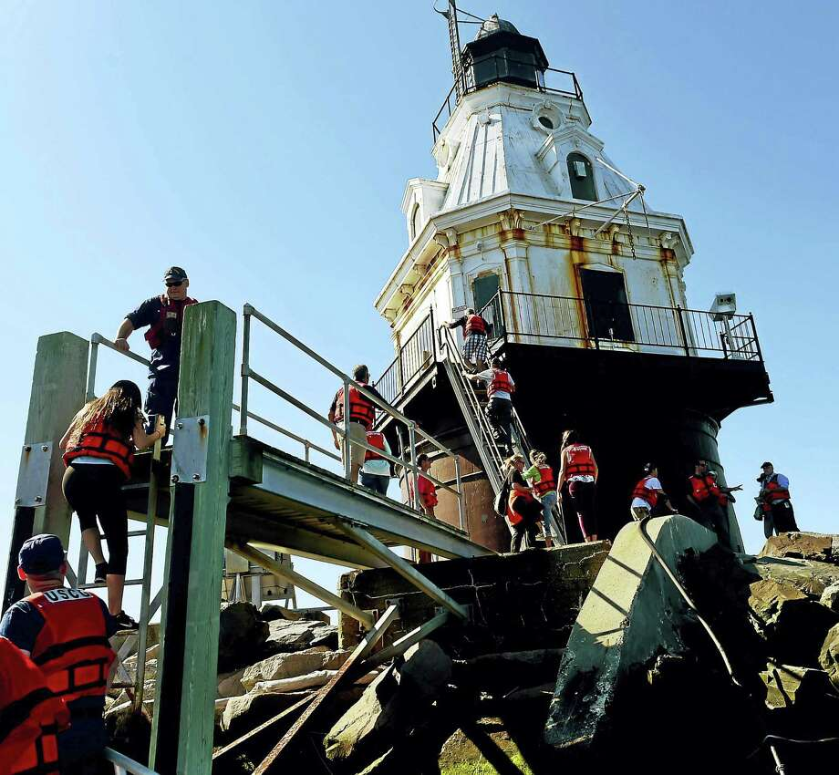 Prospective bidders are brought to the Southwest Ledge Lighthouse in New Haven Harbor on a Coast Guard boat for a visit Tuesday. Photo: Peter Hvizdak — New Haven Register   / ©2016 Peter Hvizdak