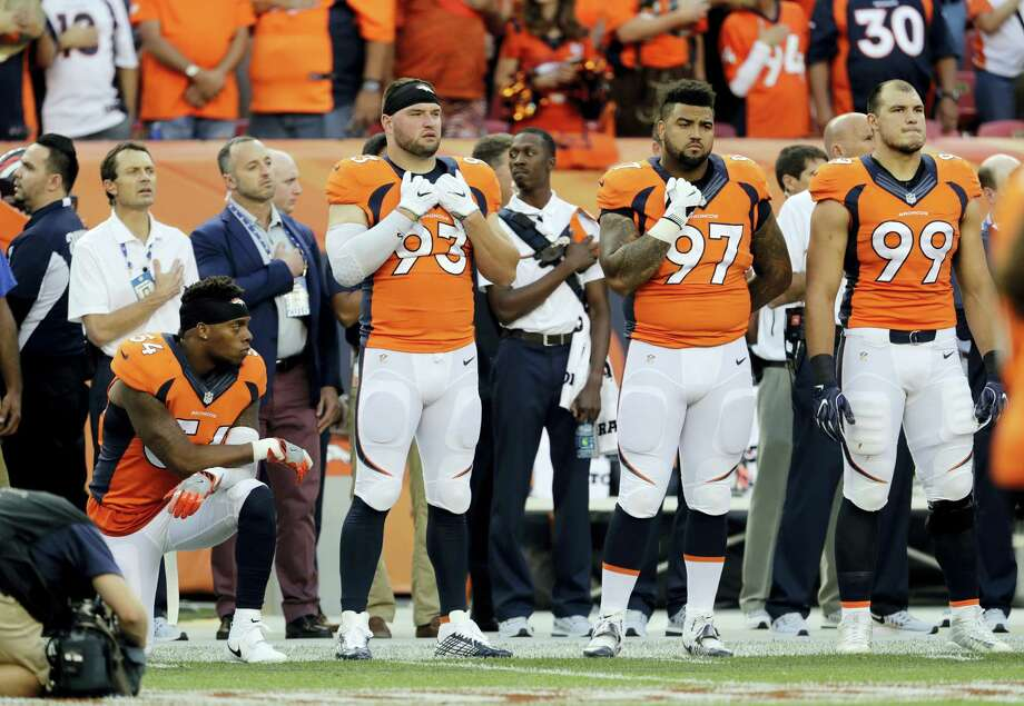 Broncos inside linebacker Brandon Marshall (54) kneels during the National Anthem prior to Thursday's game against the Panthers. Photo: The Associated Press   / FR170458 AP