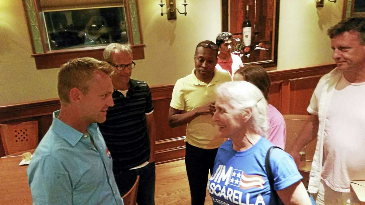 KATE RAMUNNI — NEW HAVEN REGISTER Hamden Councilwoman-at-Large Kath Schomaker congratulates Josh Elliott on his victory Tuesday over James Pascarella for the Democratic nomination for the 88th District seat in the state House of Representatives.