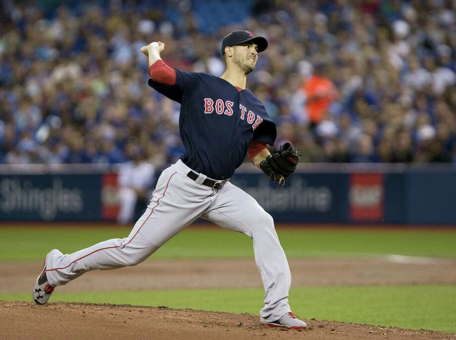 Red Sox starting pitcher Rick Porcello delivers in the first inning against the Blue Jays on Friday. Photo: Peter Power — The Canadian Press Via AP   / The Canadian Press