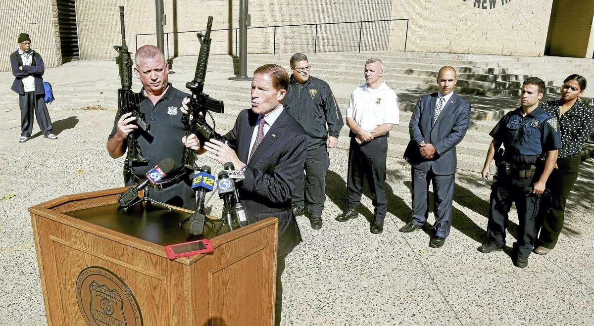 U.S. Sen. Richard Blumenthal, D-Conn., center, holds a press conference in front of the New Haven Police Department Monday to highlight the danger of paintball guns, urging an update to federal law requiring clear markings on toy and facsimile guns to include paintball guns.