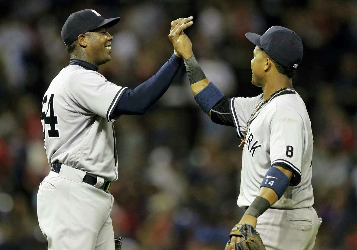Yankees relief pitcher Aroldis Chapman, left, and Starlin Castro celebrate after the Yankees beat the Indians on Thursday.