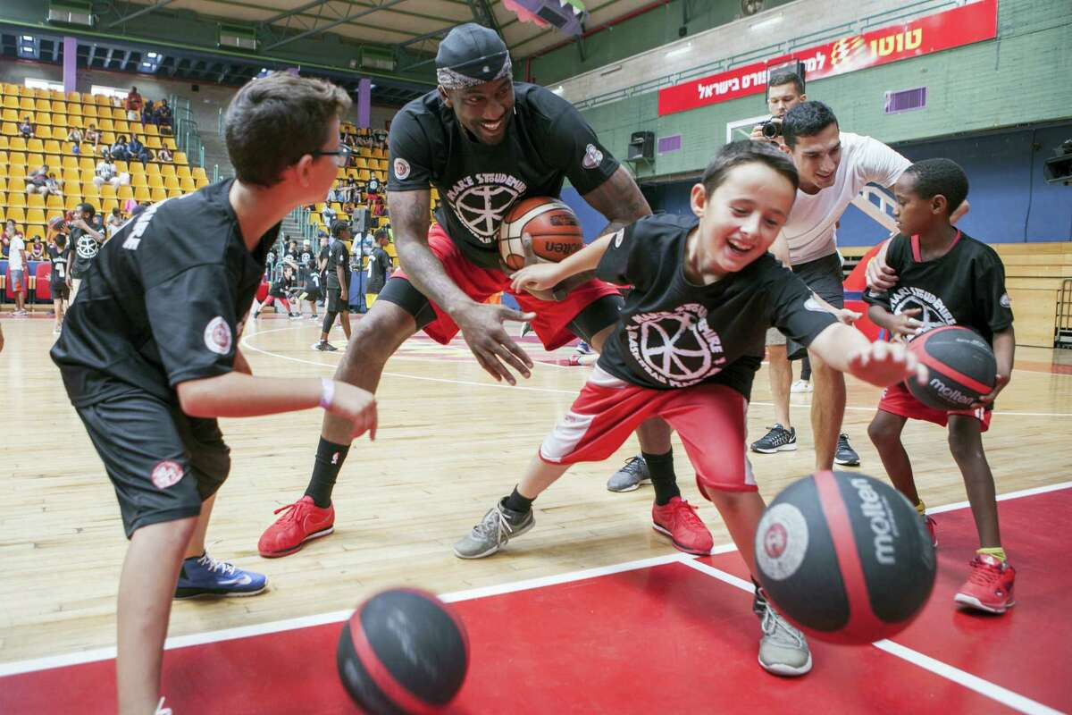 Recently retired NBA star Amare Stoudemire trains kids in Jerusalem on Aug. 8, 2016. Stoudemire signed a two-year contract Monday to play for Israeli team Hapoel Jerusalem. Stoudemire hosted some 140 Jewish and Arab kids to his basketball peace camp on Monday as he prepared to join the Israeli league.