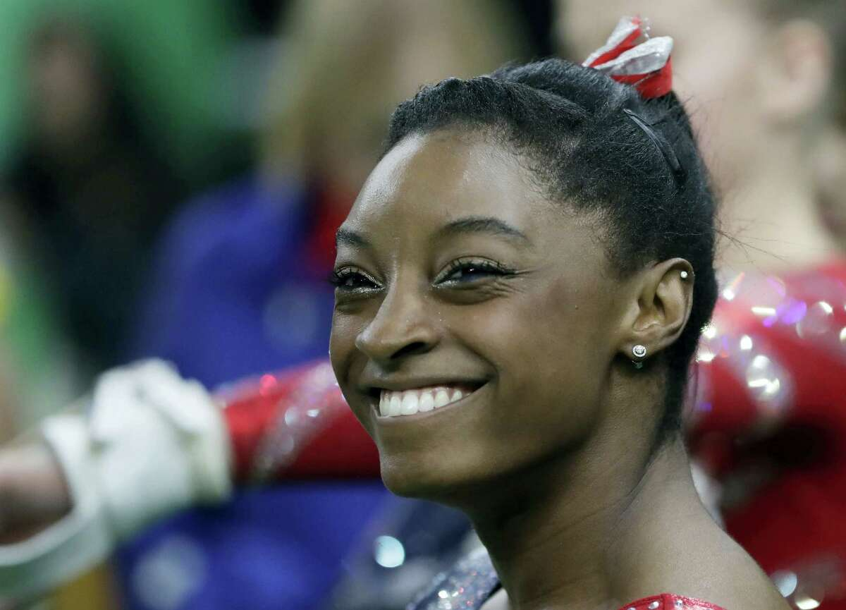 United States' Simone Biles waits to perform on the uneven bars during the artistic gymnastics women's qualification at the 2016 Summer Olympics in Rio de Janeiro, Brazil on Aug. 7, 2016.