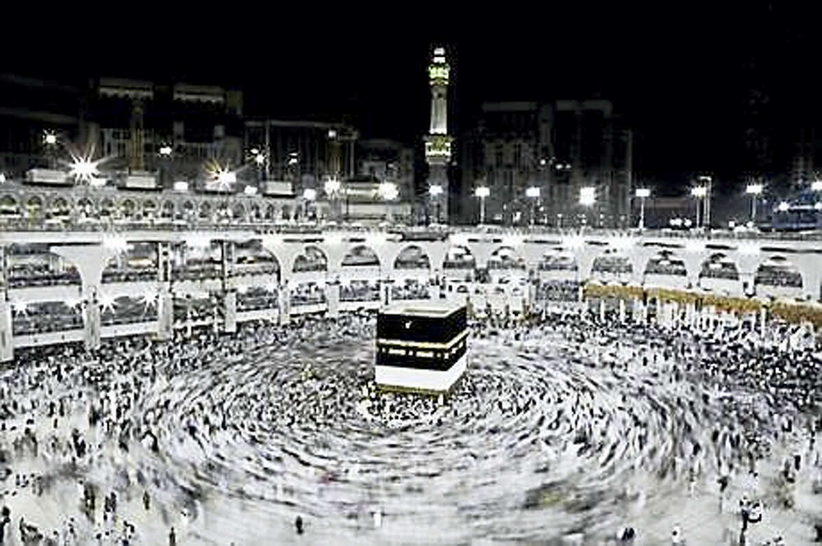In this Wednesday, Sept. 7, 2016, file photo, Muslim pilgrims circle the Kaaba, Islam's holiest shrine, at the Grand Mosque in the Muslim holy city of Mecca, Saudi Arabia. Muslim pilgrims have begun arriving at the holiest sites in Islam ahead of the annual hajj pilgrimage in Saudi Arabia, with some weeping with their hands outstretched for a fleeting touch of the Kaaba. The cube-shaped shrine, at the center of Mecca's Grand Mosque, is the site the world's 1.6 billion Muslims pray toward five times a day.