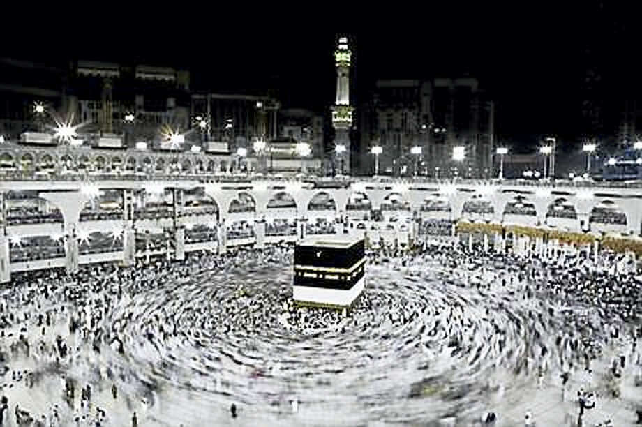 In this Wednesday, Sept. 7, 2016, file photo, Muslim pilgrims circle the Kaaba, Islam's holiest shrine, at the Grand Mosque in the Muslim holy city of Mecca, Saudi Arabia. Muslim pilgrims have begun arriving at the holiest sites in Islam ahead of the annual hajj pilgrimage in Saudi Arabia, with some weeping with their hands outstretched for a fleeting touch of the Kaaba. The cube-shaped shrine, at the center of Mecca's Grand Mosque, is the site the world's 1.6 billion Muslims pray toward five times a day. Photo: AP Photo/Nariman El-Mofty, File