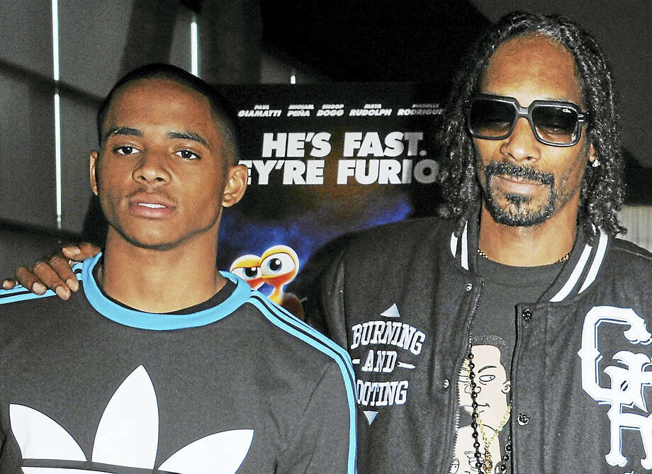 Snoop Dogg, right, poses with his son, Cordell Broadus in 2013. Photo: The Associated Press File Photo   / Invision