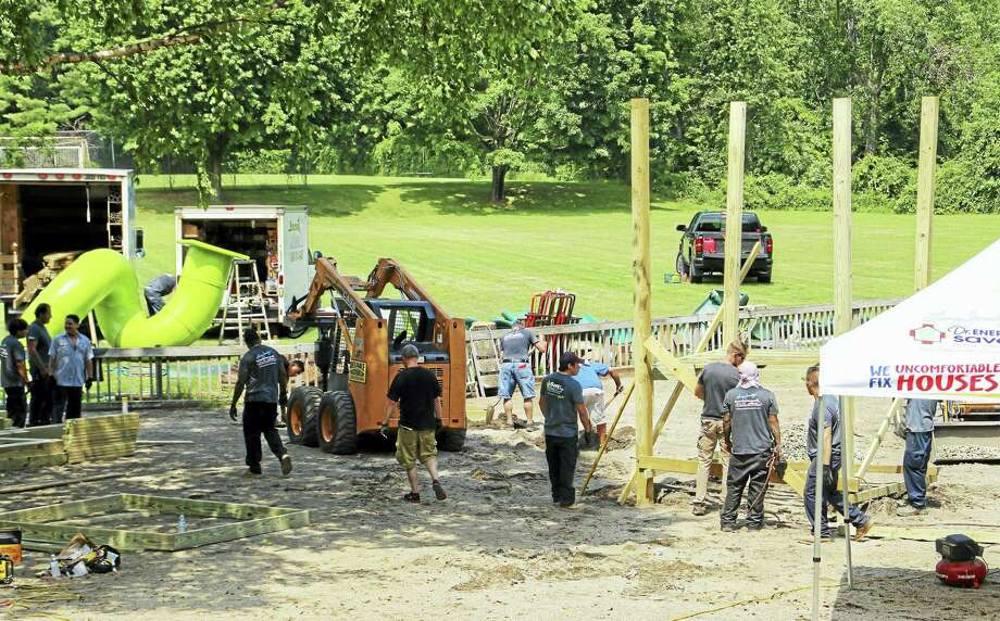 Workers build a new playground at Ansonia Nature Center. Photo: Jean Falbo — New Haven Register