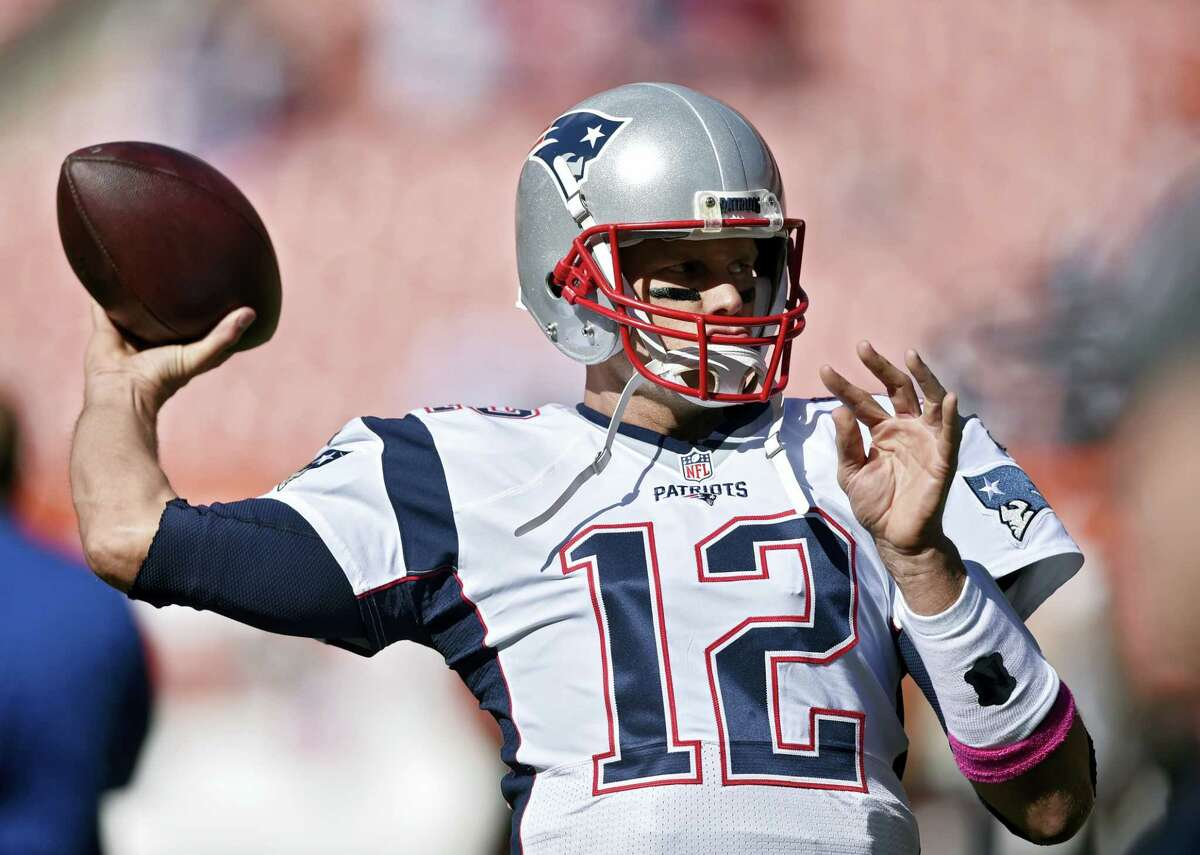 New England Patriots quarterback Tom Brady warms up before an NFL football game against the Cleveland Browns Oct. 9, 2016 in Cleveland.