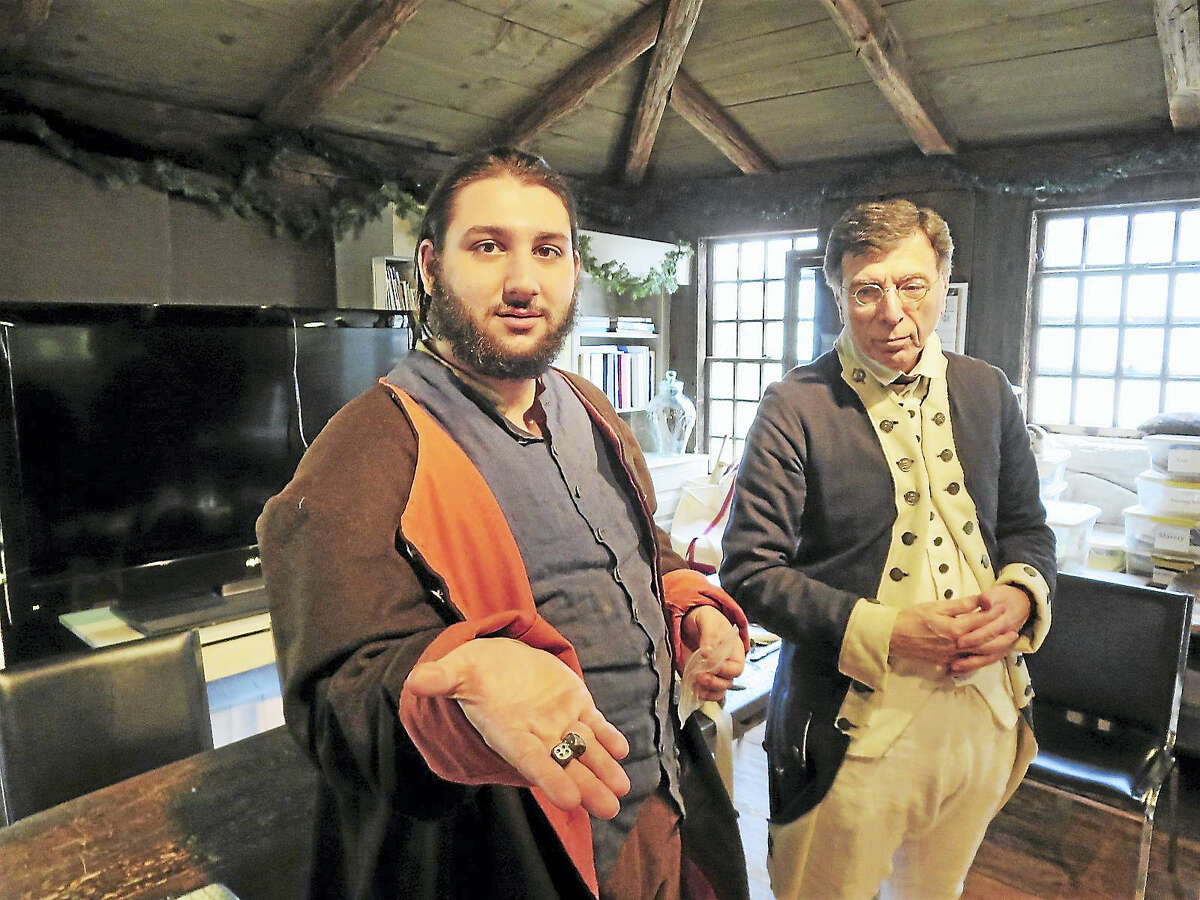 Anthony Riccio, left, displays dice from the 18th century with WDS guide Sal Carmosino.