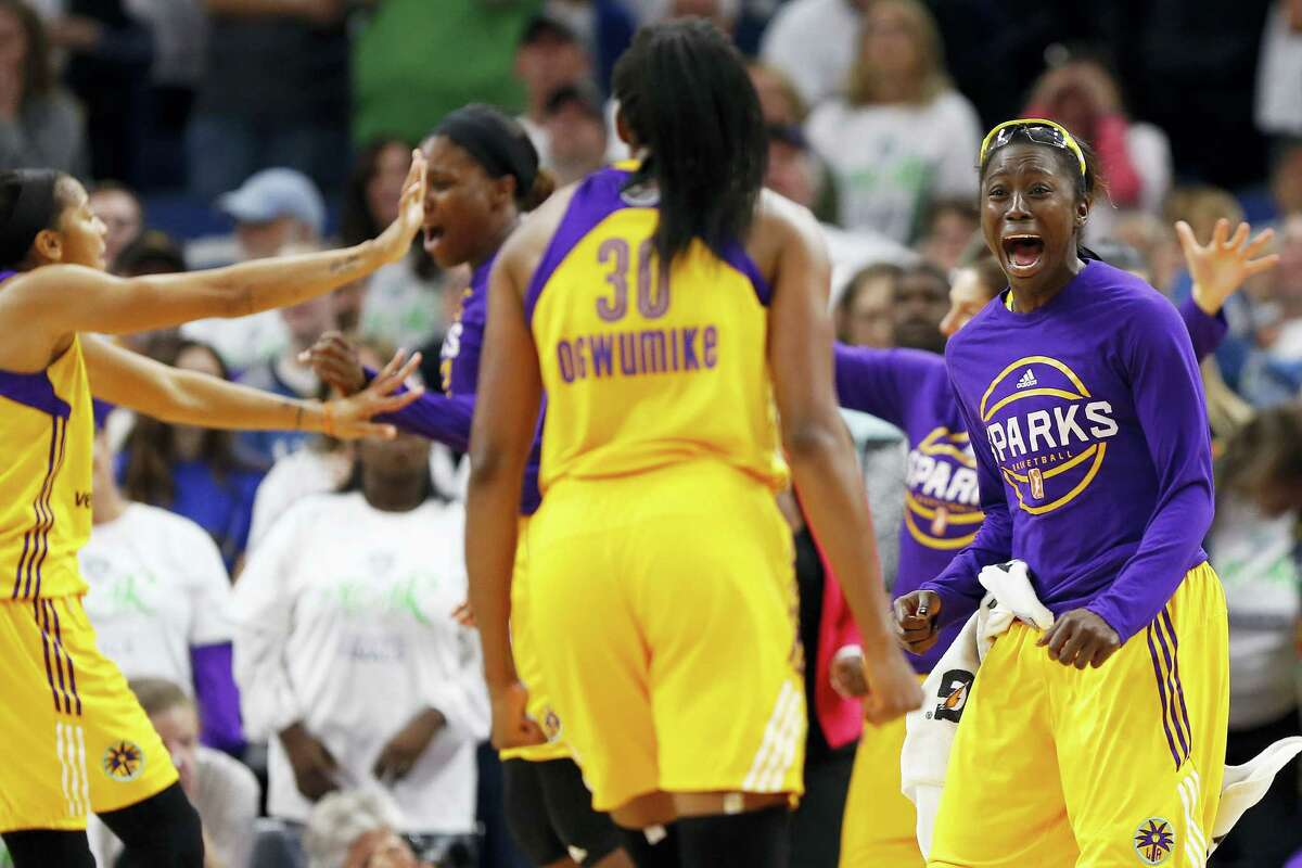 Sparks forward Essence Carson looks to teammate forward Nneka Ogwumike (30) after they won Game 1 of the WNBA finals on Sunday.
