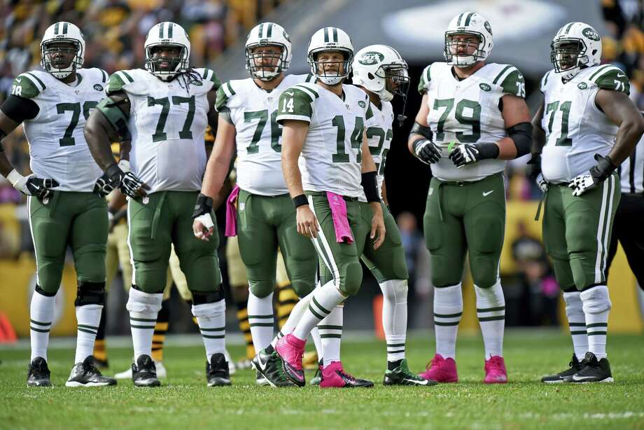 Jets quarterback Ryan Fitzpatrick (14) looks to the sidelines for a play during the second half on Sunday. Photo: Don Wright — The Associated Press   / FR87040 AP