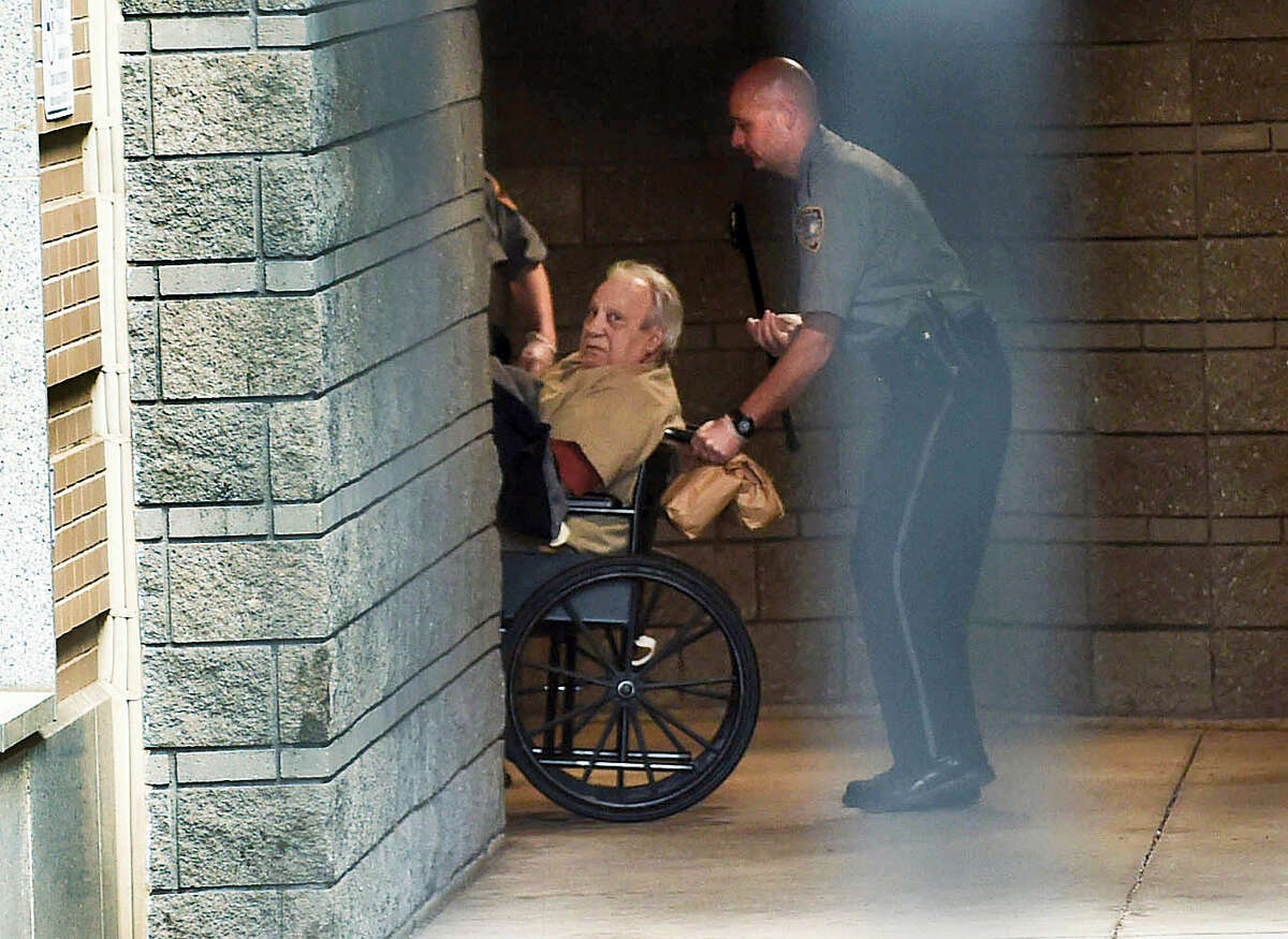 Robert Gentile is brought into the federal courthouse in a wheelchair for a continuation of a hearing in Hartford in 2015.