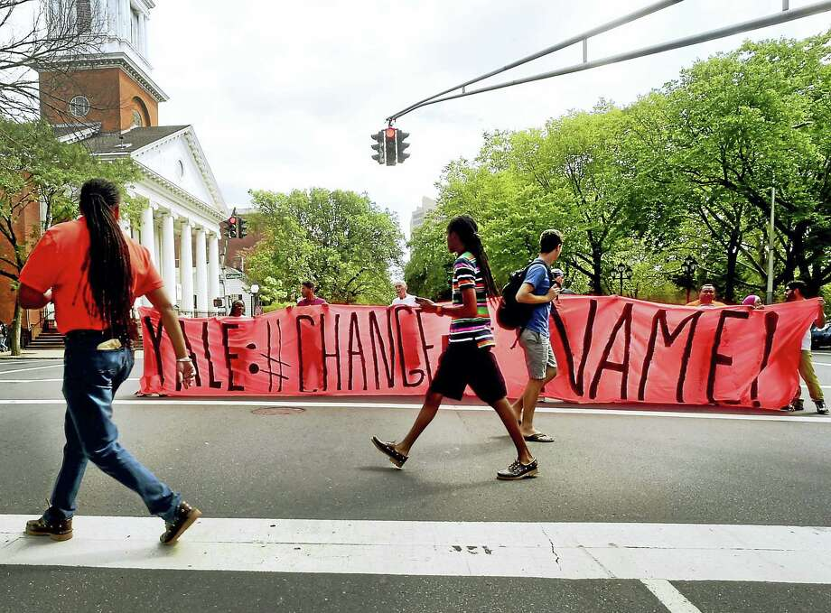 Activists hold a banner at the intersection of Elm and College treets in New Haven at Calhoun College Friday in New Haven during a protest calling for Yale to change the name of Calhoun College. Photo: Peter Hvizdak — New Haven Register   / ©2016 Peter Hvizdak