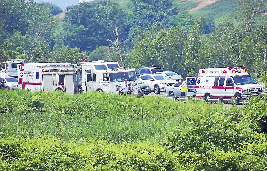 One person had to extricated from their vehicle after it crashed and rolled down an embankment Thursday afternoon on Interstate 91 northbound in New Haven near the North Haven line. Photo: Wes Duplantier — The New Haven Register