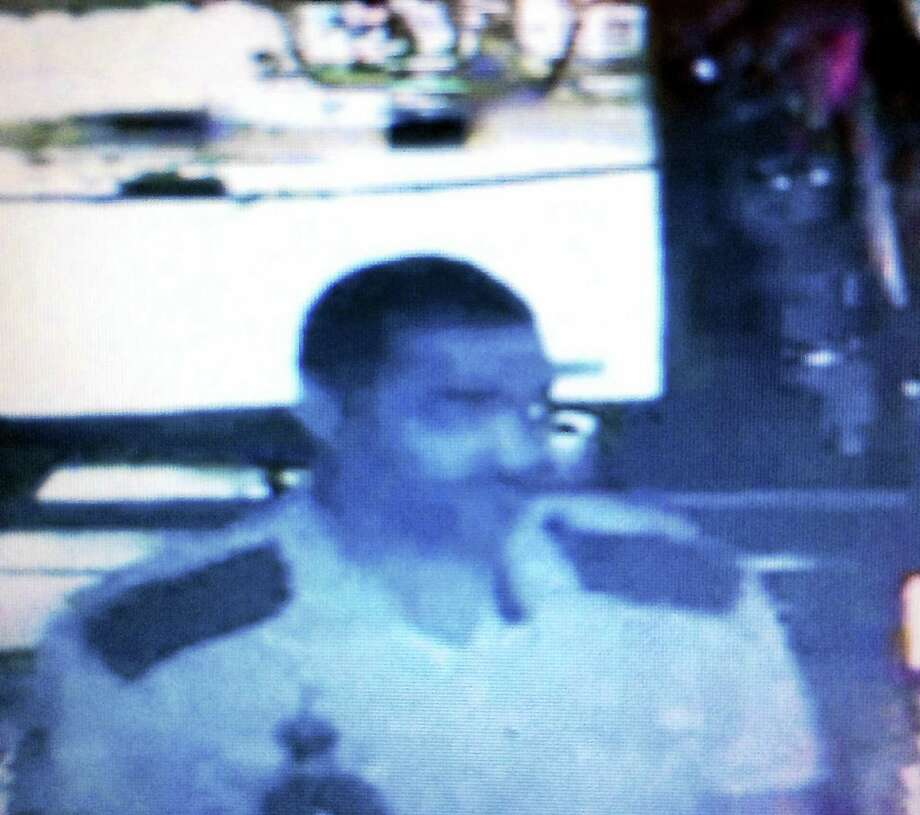 Hamden police are asking the public to help them find this man, who allegedly broke into Highwood Bar and Grill on Dixwell Avenue early Sunday. Police say the man stole three bottles of liquor. Photo: Courtesy Of Hamden Police Department