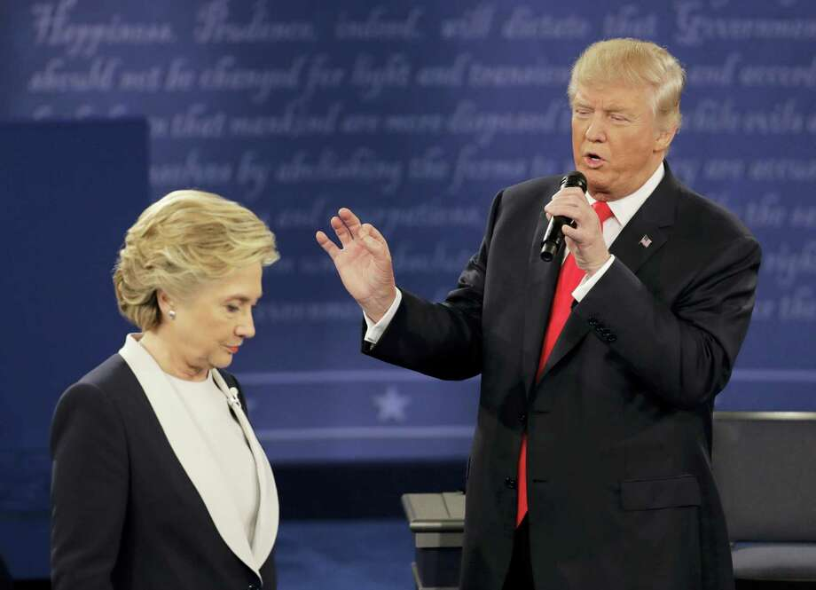 Democratic presidential nominee Hillary Clinton walks past Republican presidential nominee Donald Trump during the second presidential debate at Washington University in St. Louis, Sunday, Oct. 9, 2016. (AP Photo/Patrick Semansky) Photo: AP / Copyright 2016 The Associated Press. All rights reserved.