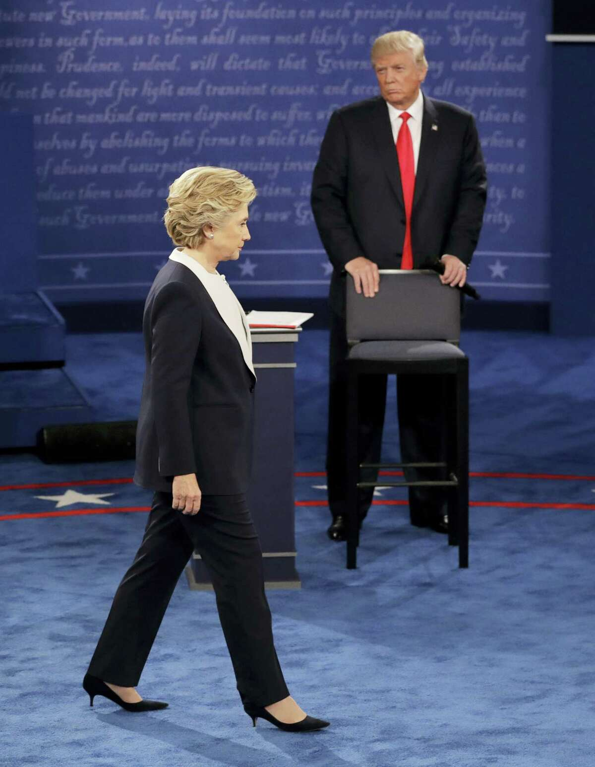 Republican presidential nominee Donald Trump watches Democratic presidential nominee Hillary Clinton during the second presidential debate at Washington University in St. Louis, Sunday, Oct. 9, 2016. (AP Photo/Patrick Semansky)