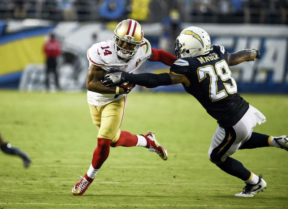 San Francisco 49ers wide receiver Eric Rogers, left, pushes off San Diego Chargers cornerback Craig Mager during the first half of an NFL preseason football game on Sept. 1, 2016 in San Diego. Photo: AP Photo/Denis Poroy   / FR59680 AP