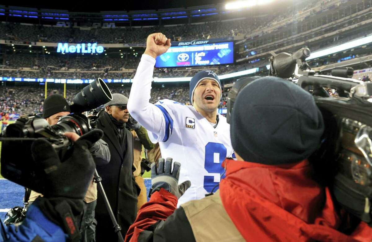 Dallas Cowboys quarterback Tony Romo (9) gestures while leaving the field after an NFL football game against the New York Giants, Sunday, Nov. 24, 2013 in East Rutherford, N.J. The Cowboys won 24-21.