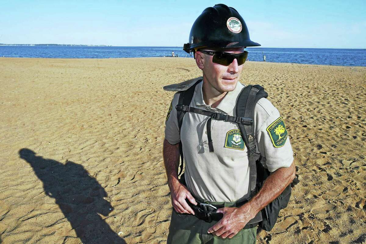West Haven resident Christopher Kostopoulos, a CT DEEP Wildland Firefighter talks about his experience fighting wildfires in Idaho and Wyoming, Thursday, September 22, 2016, at Dawson Beach in West Haven. (Catherine Avalone/New Haven Register)