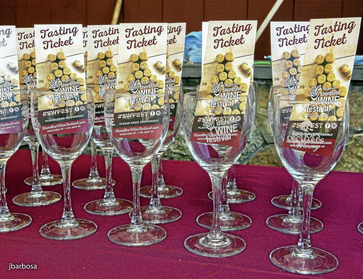 Wine-sampling glasses and tasting tickets beckon attendees.