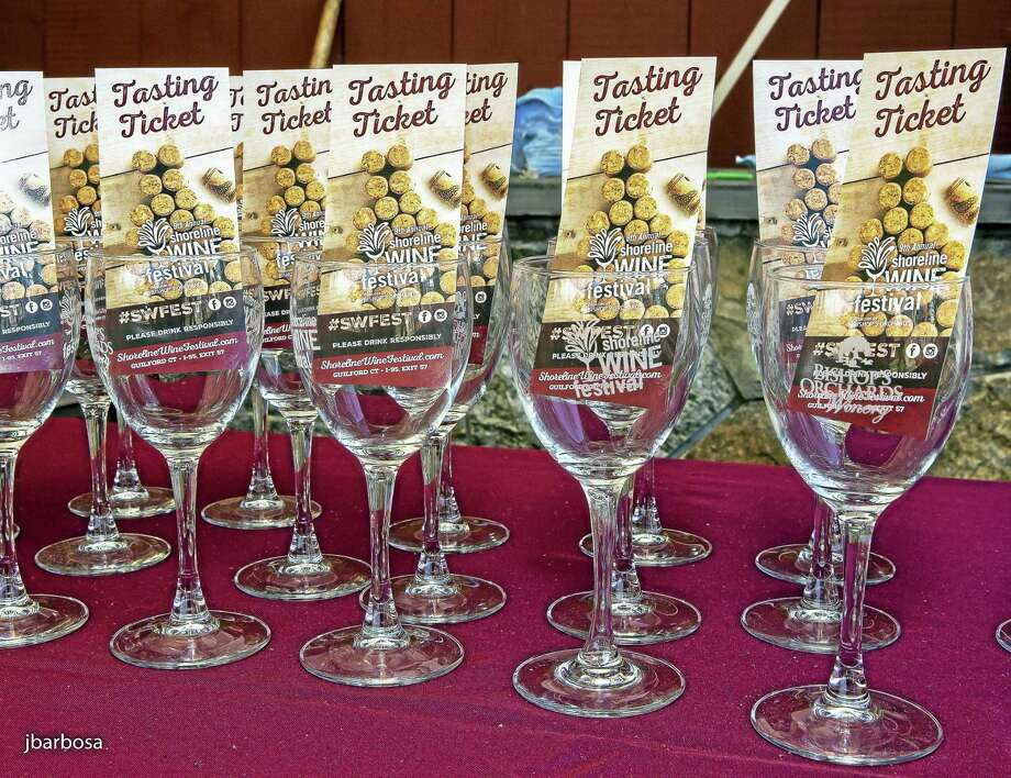 Wine-sampling glasses and tasting tickets beckon attendees. Photo: Photo Courtesy Of Judith L. Barbosa   / © Judith L. Barbosa