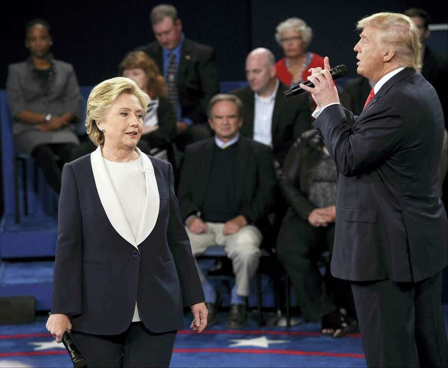 Democratic presidential nominee Hillary Clinton, reacts as Republican presidential nominee Donald Trump during the second presidential debate at Washington University in St. Louis, Sunday, Oct. 9, 2016. (Saul Loeb/Pool via AP) Photo: AP / Copyright 2016 The Associated Press. All rights reserved.