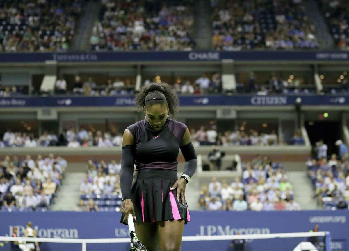 Serena Williams walks back to the service line between serves from Karolina Pliskova on Thursday.