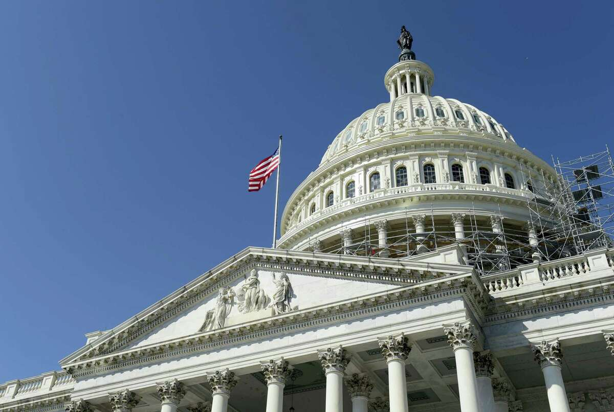 An American flag flies over Capitol Hill in Washington Tuesday as lawmakers return from a 7-week break.