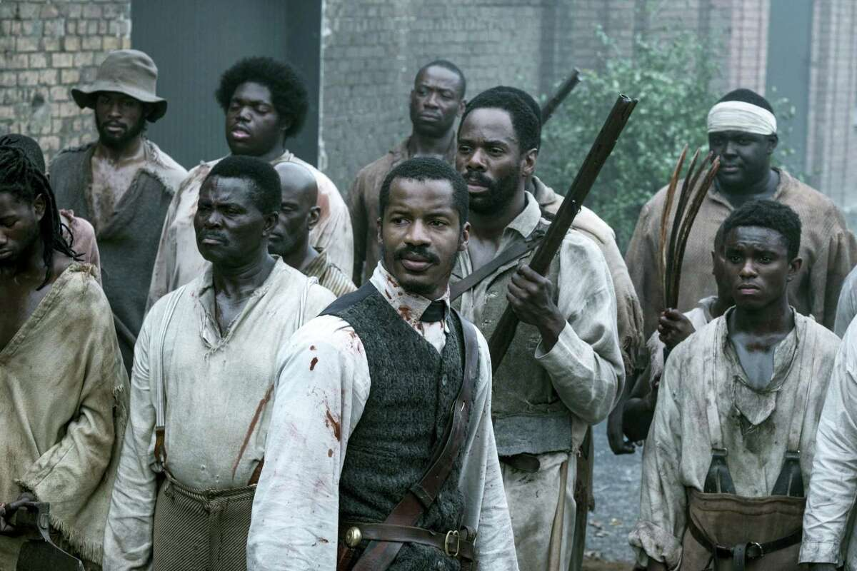 """In this file image released by Fox Searchlight Films shows Nate Parker as Nat Turner, center, in a scene from """"The Birth of a Nation."""" Nate Parker's Nat Turner biopic """"The Birth of a Nation,"""" opened with a disappointing $7.1 million, according to studio estimates on Oct. 9, 2016."""