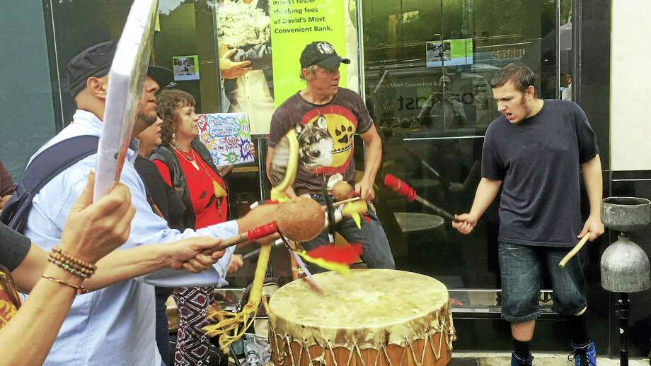 ED STANNARD — NEW HAVEN REGISTER  Drummers join the protest of the Dakota Access pipeline outside TD Bank, 994 Chapel St., on Wednesday. Photo: Journal Register Co.
