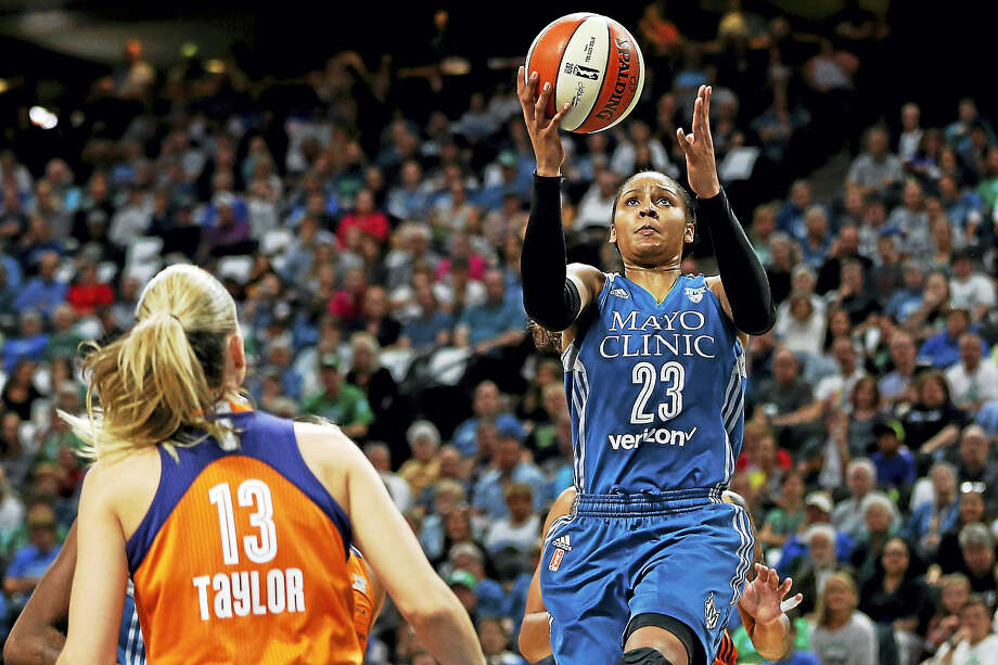 Maya Moore, right and the Minnesota Lynx will face off against the Los Angeles Sparks in the WNBA Finals beginning on Sunday. Photo: The Associated Press File Photo   / FR170489 AP